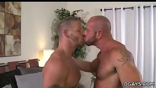 Muscular gay matures having fun