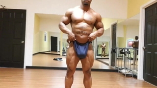 Man showing off his body in the gym