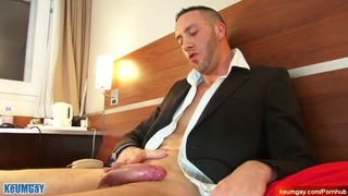 In Suits Guy Gets Wanked his Huge Dick in Spite of himself