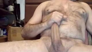 Hairy fit bear enjoys his stiff meat