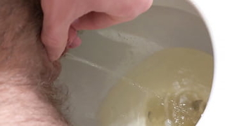 Stroking my ftm cock as I piss