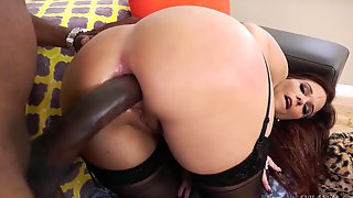 Buxom MILF takes black monster sized cock in her ass