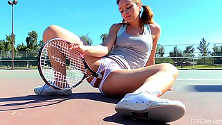 Tennis babe in crotchless panties plays with her cunt