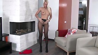 Nice girl in black sheer pantyhose at home