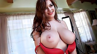Red lingerie clad Tessa Fowler shows off her lovely legs and huge natural tits