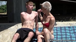 Pixie grandma swallows young cock beneath bridge