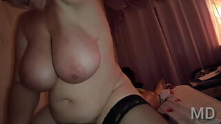 Adult Russian woman with huge tits rides a young cock