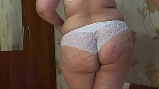 Sexy BBW doggy style fucks with a dildo near the mirror and shakes big booty.