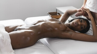 Glistening ebony statue of perfection on the massage table