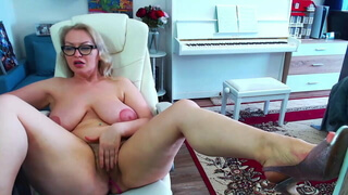 Russian mature caresses her plump and sexy body on cam