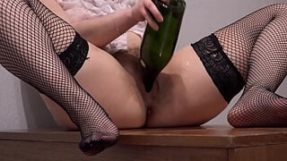 A brunette in a wet blouse masturbates with a bottle and shows her hairy pussy with abundant vaginal discharge from pleasure Home fetish