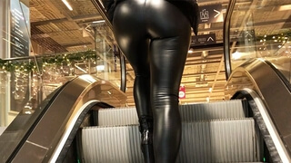 Amateur Girl with Latex Leggings Searching for a Perfect Christmas Tree
