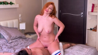 Red-haired beauty with big tits rides on a dick